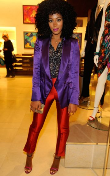 Here, Solange colorblocks from (as Tyra would say it) 'H to T' in a Salvatore Ferragamo purple blazer and rust cropped slacks with a pair of Ferragamo purple and fuchsia colorblocked sandals. She breaks up the look with a printed top by Maki Oh