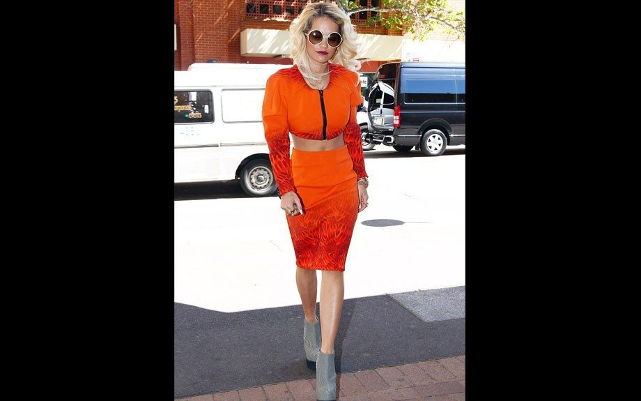 Rita Ora looked great in Sydney in an orange, cropped bomber and pencil skirt from Mark Fast's Spring 2012 collection and a pair of Senso Diffusion Boots.