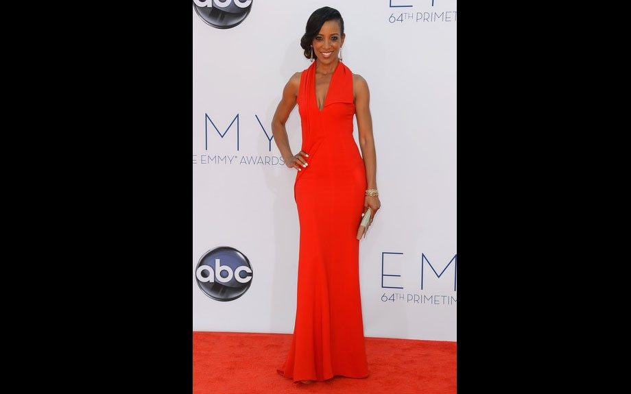 Shaun Robinson wore a chic red halter gown to the Emmy Awards and a chignon bun.