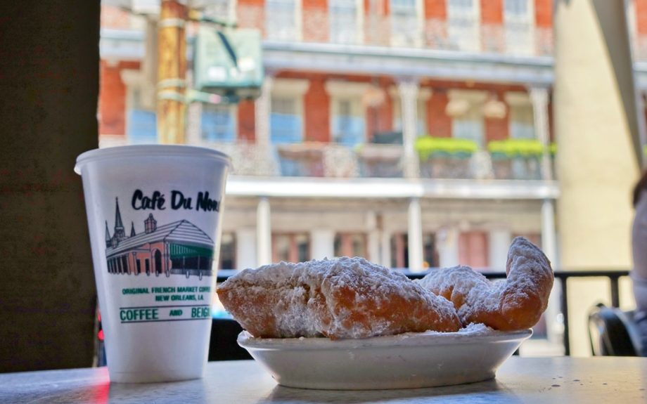 1. Beignets are always served fresh and hot, and tasted best alongside a cup of café au lait.  	Photo Credit: Paul Broussard