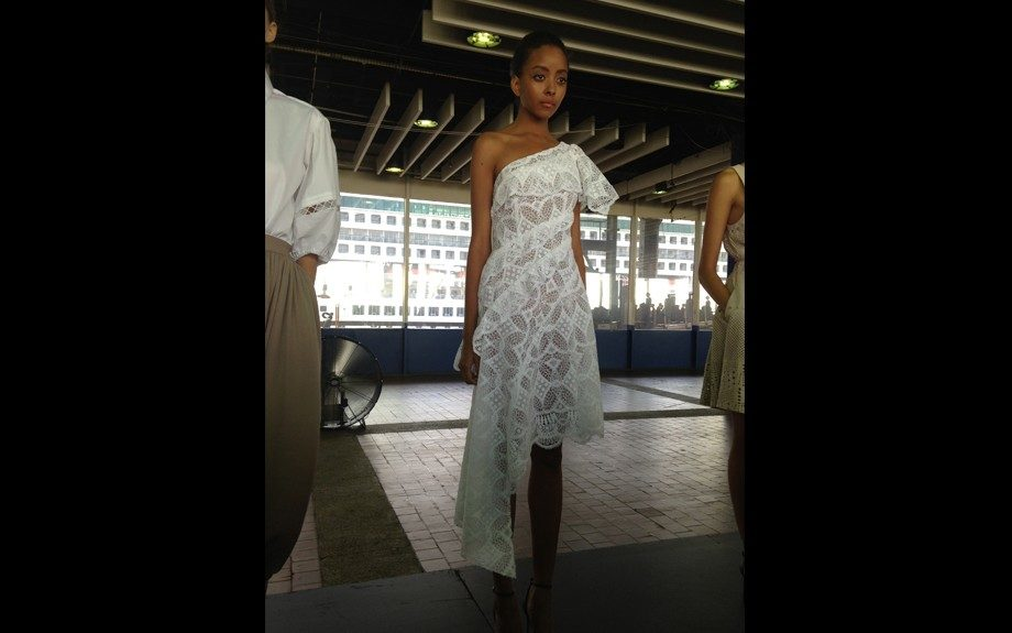 Another Catherine Malandrino model looking soft in a one shoulder white number.