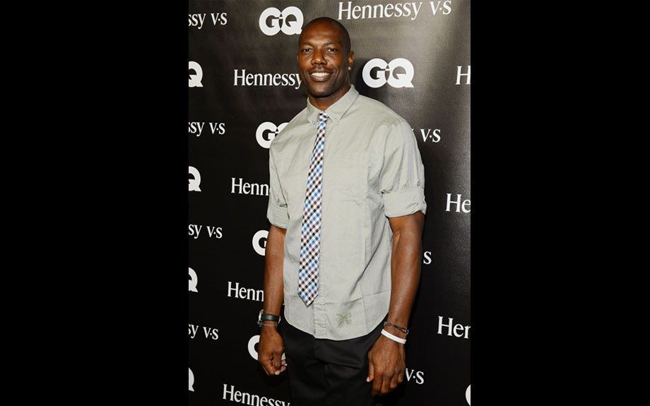 Terrell Owens attended Chris Paul's event in a grey shirt, patterned tie and dark slacks.