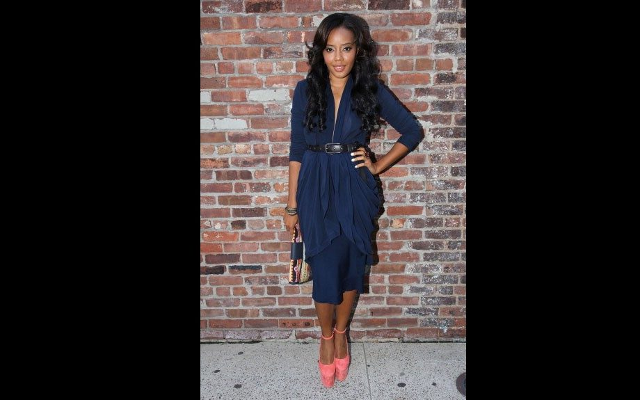 Angela Simmons is stunning in a Donna Karan jacket and skirt, Olcay Gulson suede pumps, and a clutch by Rachel Roy.