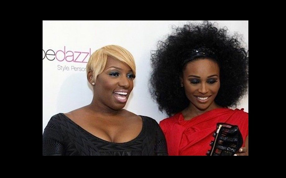 Nene Leakes poses in a black dress, with Cynthia Bailey looking great in red. Photo Credit: Nene's Twitter