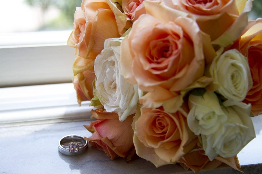 Her bouquet was composed of peach and white roses to complement her stunning peach champagne engagement ring