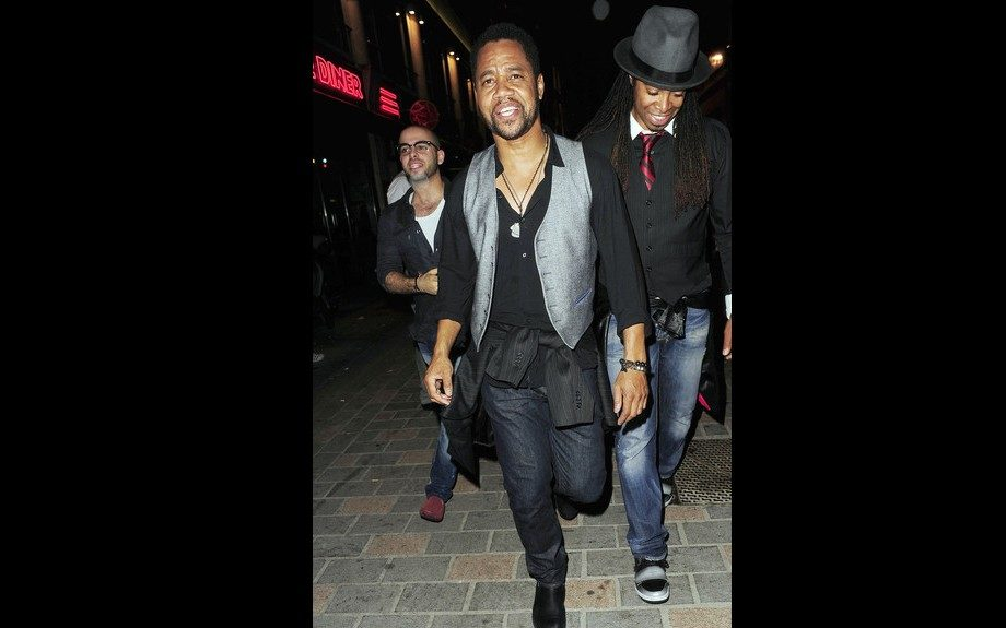Cuba Gooding Jr. in his signature vest look and that waist-tied-top to add a cool touch