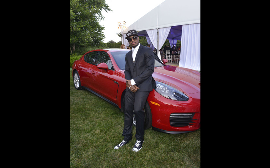 <span><span><span><span>Ne-Yo poses for picture on red Porsche sponsored by Porsche North America</span></span></span></span>