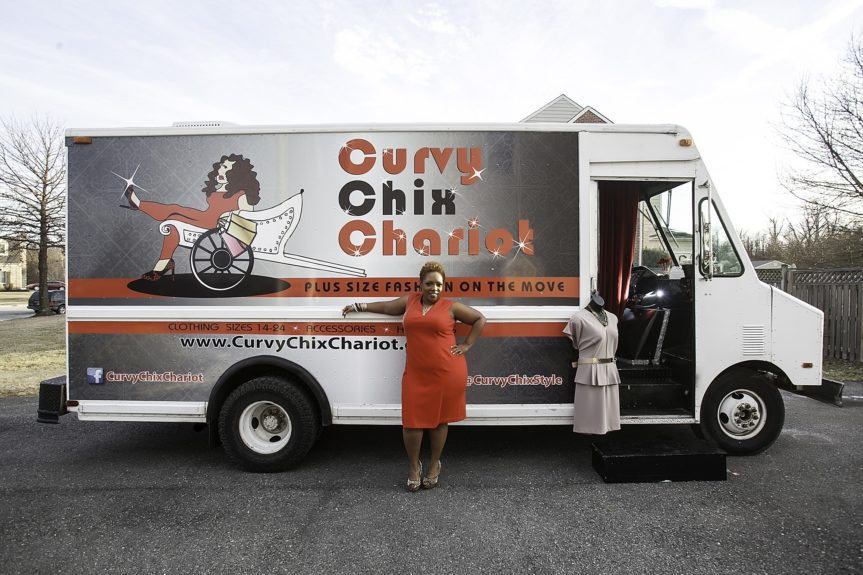 Owner Donna Hundley strikes a pose in front of her mobile fashion boutique
