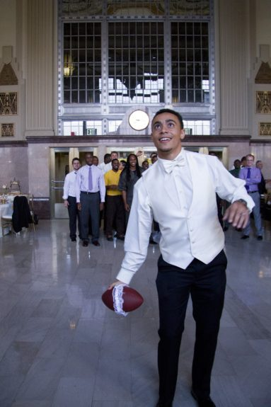 With all of his college football buddies in the building, there's no better way to toss the garter