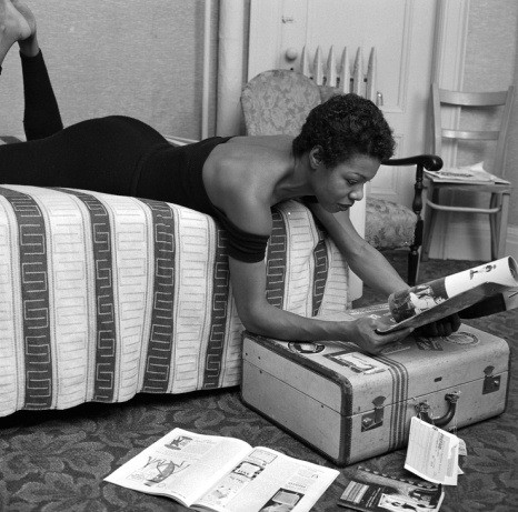 Maya Angelou doing a little reading in her dressing room before her performance at the Village Vanguard in New York City. Photo: G. Marshall Wilson/EBONY