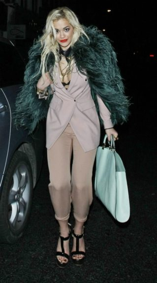Jay-Z's newest protege sports green accessories to complement this nude look at friend's birthday party