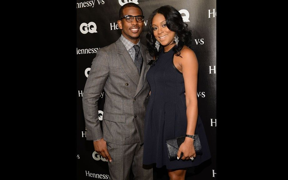 Chris Paul attended his very own event in a gray suit, checkered shirt and dark tie. Jade wore a black cocktail dress and clutch.