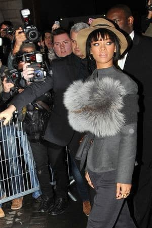 Rihanna attended the Lanvin show with a statement fur wrapped around her chest. Bold move, and we love it.