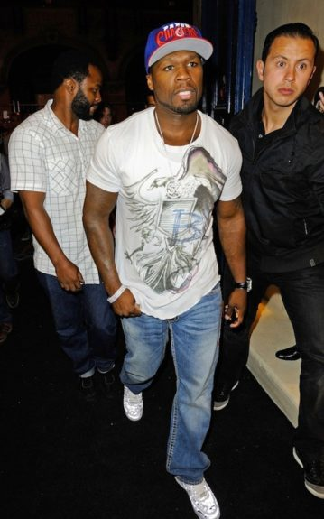The birthday boy 50 Cent, sporting a Balmain graphic tee, jeans, and a fitted
