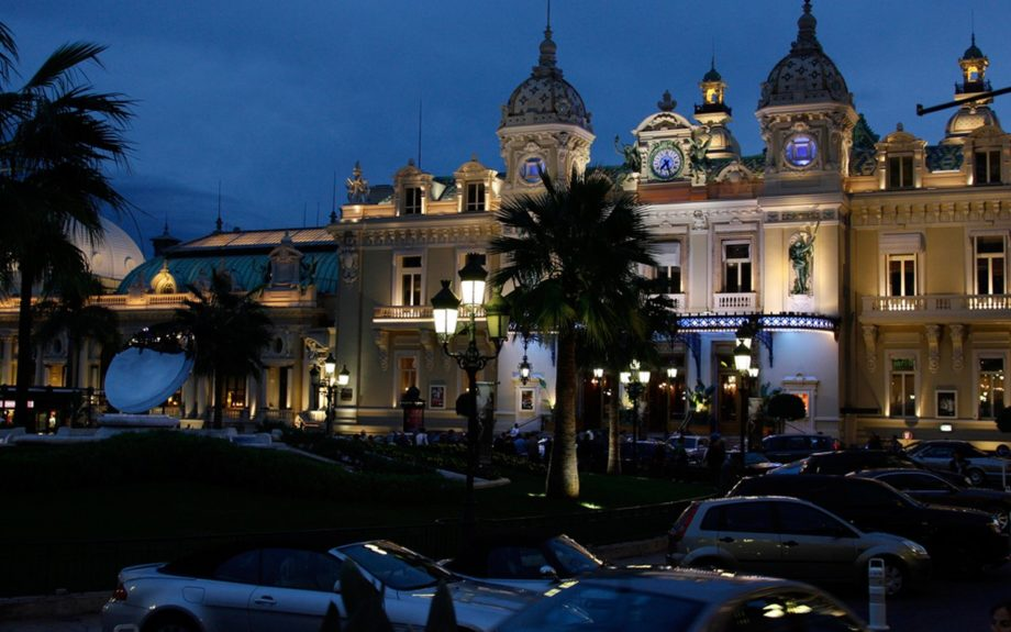 Monte Carlo casino in Monaco at night with cars