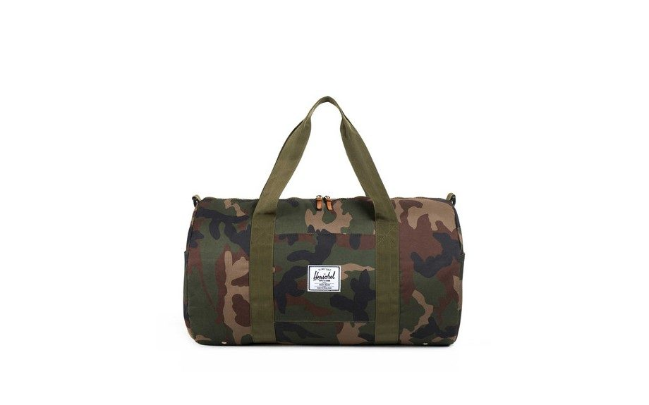 "<a href=""http://shop.herschelsupply.com/collections/featured-duffles/products/sutton-duffle-woodland-camo"" target=""_blank""><strong>Sutton Duffle</strong></a> ($64.99, available at Herschel Supply Co.)"