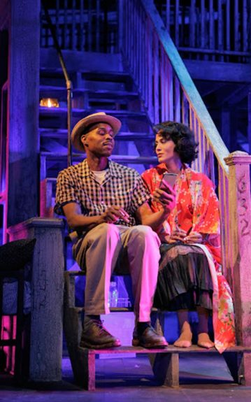Mitch (Wood Harris) comforts Blanche on the stairs of the tenement. (Photo by Ken Howard)