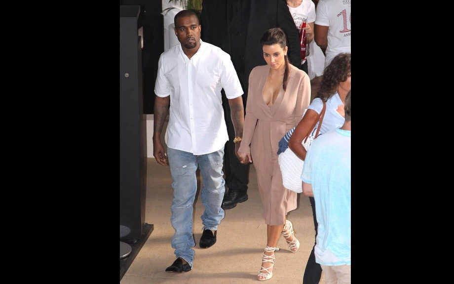 We'd say this outfit of Kanye's is yacht appropriate, pairing a crisp white shirt with a pair of comfy jeans and loafers