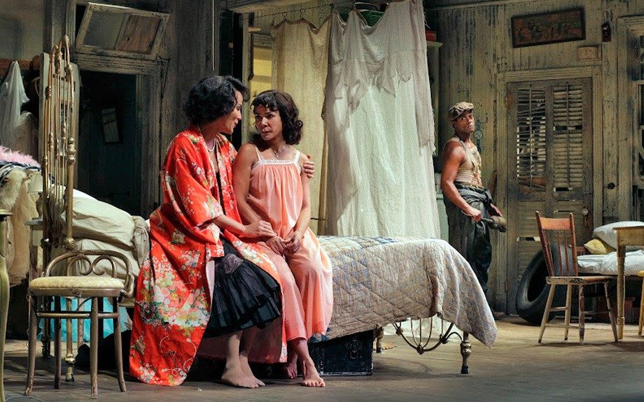 Sisters Blanche and Stella (Rubin-Vega) chat as Stanley looks on. (Photo by Ken Howard)
