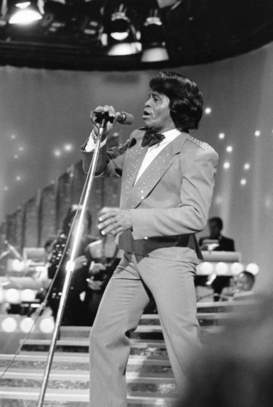 "James Brown performs at the 1986 American Black Achievement Awards. (Isaac Sutton/EBONY Collection) Sponsored By: <a href=""http://www.getonupmovie.com/"" target=""_blank"">Get On Up</a> Now Playing!"