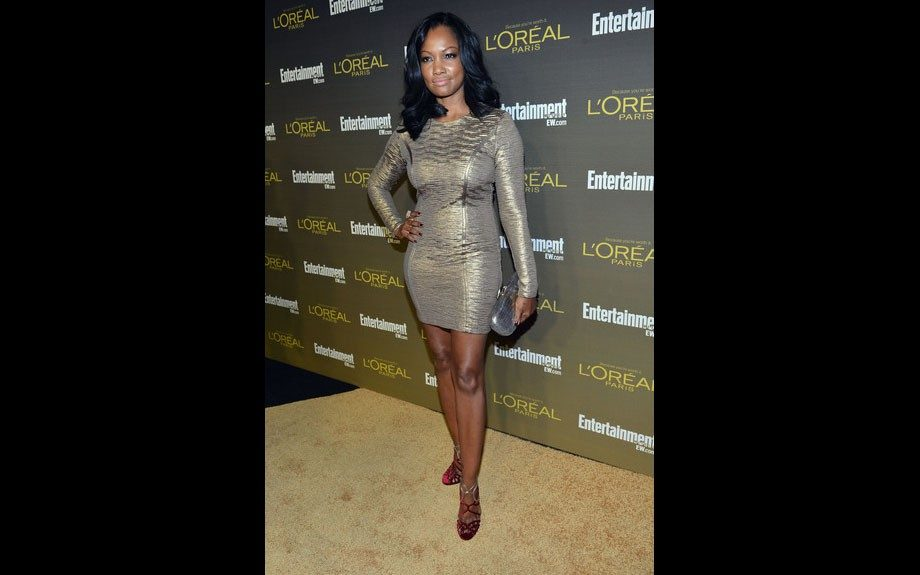 Garcelle Beauvais wore a long sleeved textured gold dress and Jimmy Choo sandals.