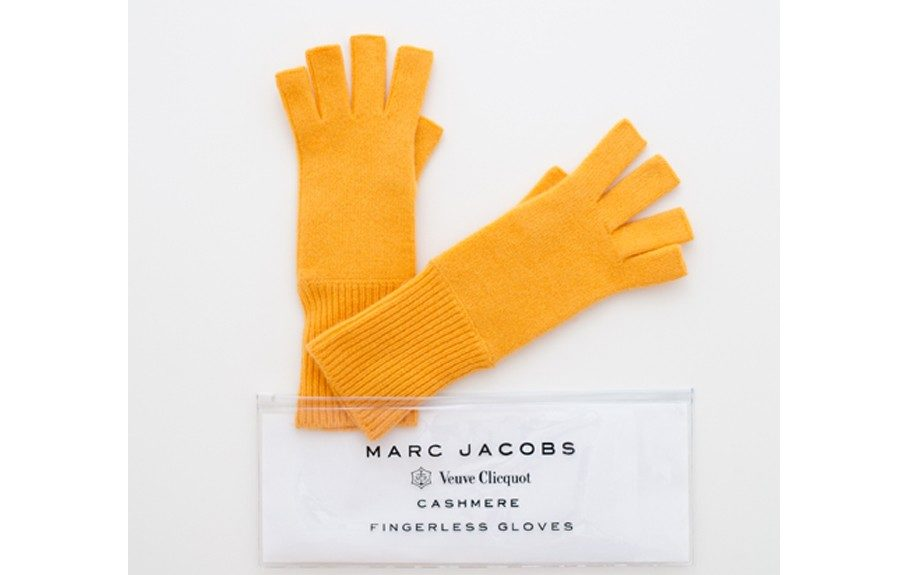 Marc Jacobs 100% Cashmere fingerless Gloves. The better to pop bottleswtih! ($35; marcjacobs.com)