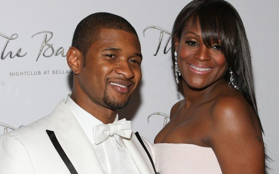 Looking lavish in white, Usher and Tameka on the red carpet