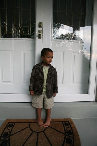 Kofi, age 2. Born in 2004, Delphine describes Kofias a little rebel who is very inspired by his older brothers.