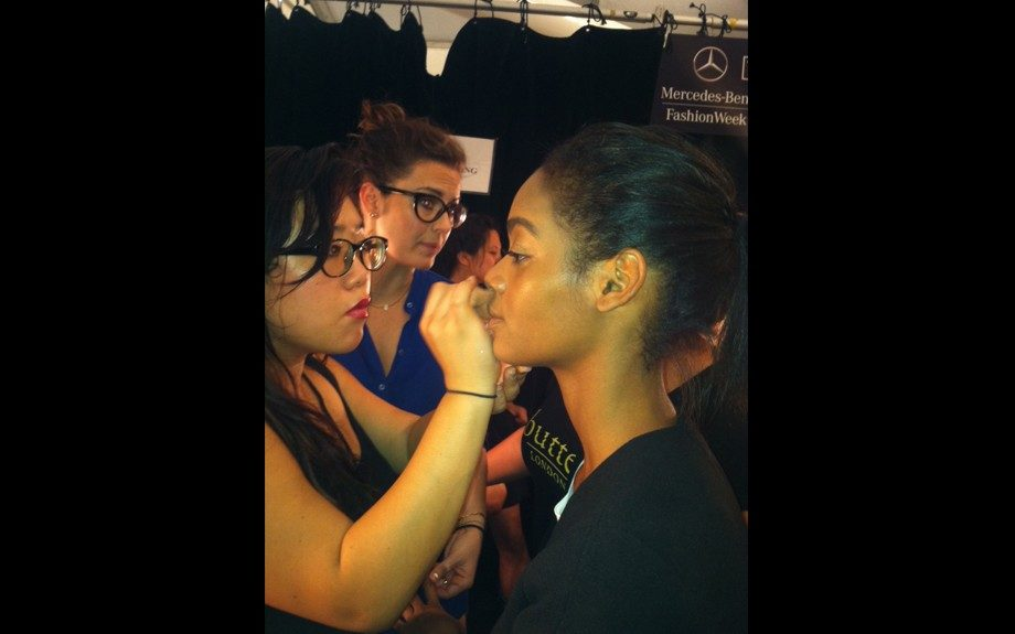 Models getting ready backstage at the Milly presentation.