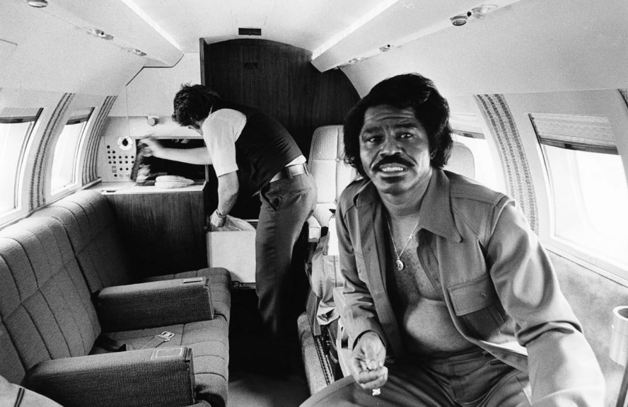 "An aide inspects the interior of a jet with singer James Brown. (G. Marshall Wilson/EBONY Collection) Sponsored By: <a href=""http://www.getonupmovie.com/"" target=""_blank"">Get On Up</a> Now Playing!"