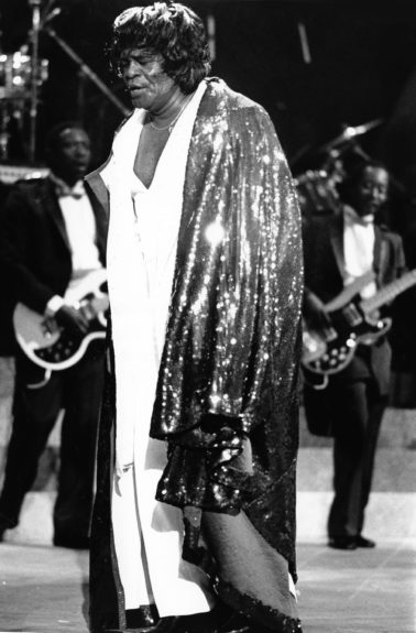 "James Brown performs his ""Living In America"" pay per view TV concert  held in L.A. (James L. Mitchell/EBONY Collection) Sponsored By: <a href=""http://www.getonupmovie.com/"" target=""_blank"">Get On Up</a> Now Playing!"