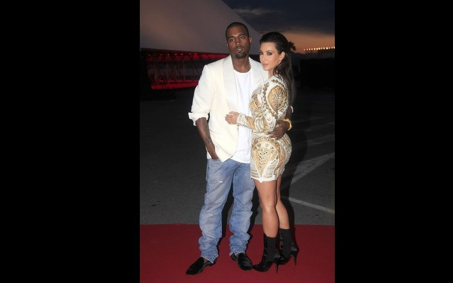 Here, Kanye rocks the same jeans and loafers we spotted him in earlier and tosses on a white tee and white blazer as he hosted the Cannes Film Festival premier of <em>Cruel Summer</em>