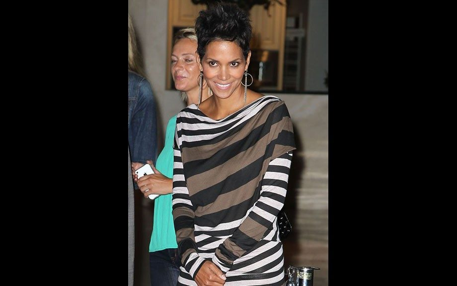 Halle Berry attended the Hollywood Premiere of Cybergeddon in a striped dress by Vivienne Westwood, black pumps, and dangling silver earrings.
