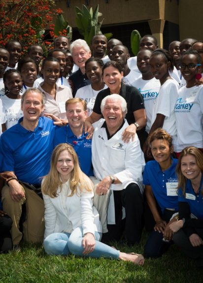 President Clinton and Chelsea Clinton with Bill Austin and staff from the Starkey Hearing Foundation on August 5, 2013.