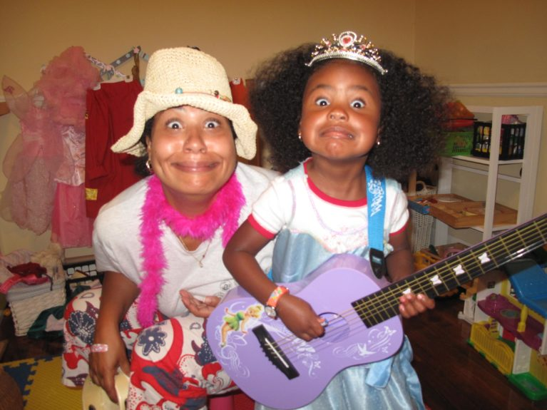 """Naimah and her kindergartner in play mode: """"I like to dress up as a fairy bride,"""" says Suriyah."""
