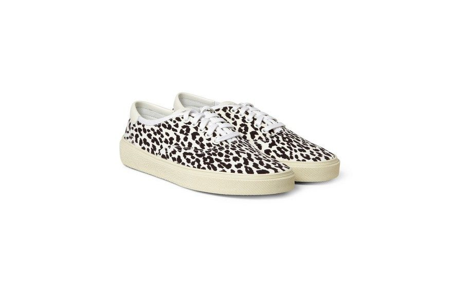 """<strong>Wear them to the Drake x Lil' Wayne concert coming up.</strong> <a href=""""http://www.mrporter.com/product/411097"""" target=""""_blank"""">Saint Laurent Baby Cat Print Sneakers, $395</a>"""