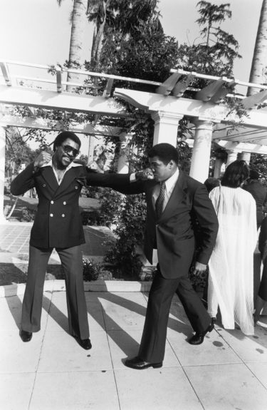 <p> Muhammad Ali and and actor Carl Weathers engage in playful banter at Ali's Semi-Open House in June of 1979(Isaac Sutton/Ebony Collection)</p>