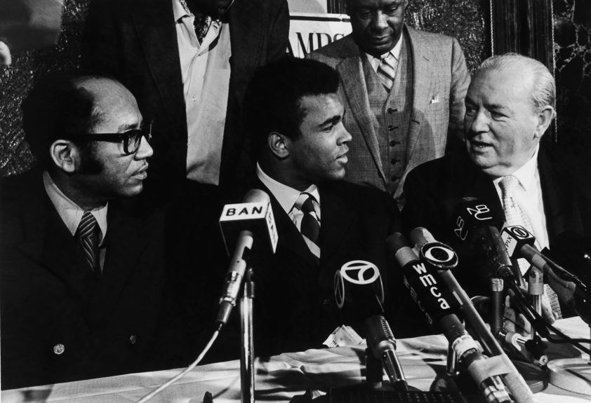<p> Muhammad Ali appears at a press conference with Leroy Johnson and congressman Edwin B. Dooley in 1970 (G. Marshall Wilson/Ebony Collection)</p>