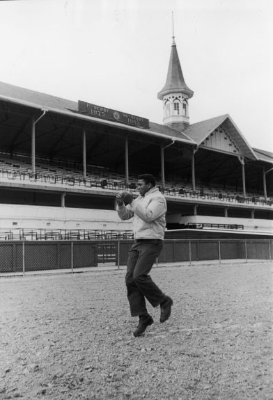 <p> Muhammad Ali shadowboxes at Churchill Downs, the site of the famed Kentucky Derby in Lousville, KY (Moneta Sleet, Jr./Ebony Collection)</p>
