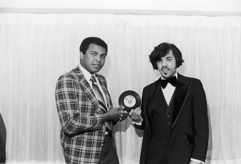 <p> Muhammad Ali and David Muhammad hold a copy of a Scorpian record in October of 1978 (Maurice Sorrell/Ebony Collection)</p>
