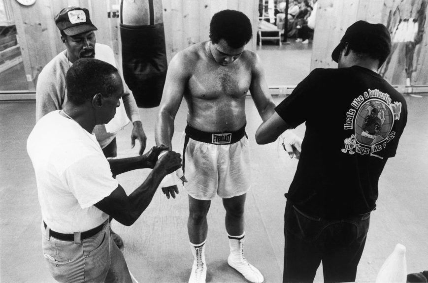 <p> Muhammad Ali having tape removed by Wali Youngblood Muhammad, Soria Brown, and his trainer Drew Bundini Brown in July 1978 (Vandell Cobb/Ebony Collection)</p>