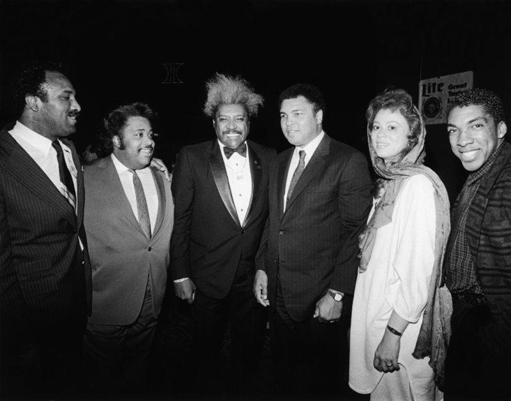 <p> Muhammad Ali and his wife Lonnie are photographed with Ali's brother Rahaman, Rev. Al Sharpton, boxing promoter Don King, and actor Stan Shaw at Mike Tyson's heavyweight champion coronation November 1986 (Isaac Sutton/Ebony Collection)</p>