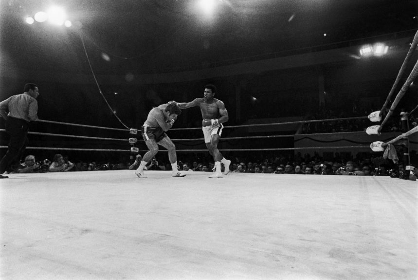 <p> Muhammad Ali delivers a devasting blow to Jerry Quarry during their boxing match on October 26, 1970 at the Atlanta Municipal Auditorium in Georgia (Hal A. Franklin II/Ebony Collection)</p>