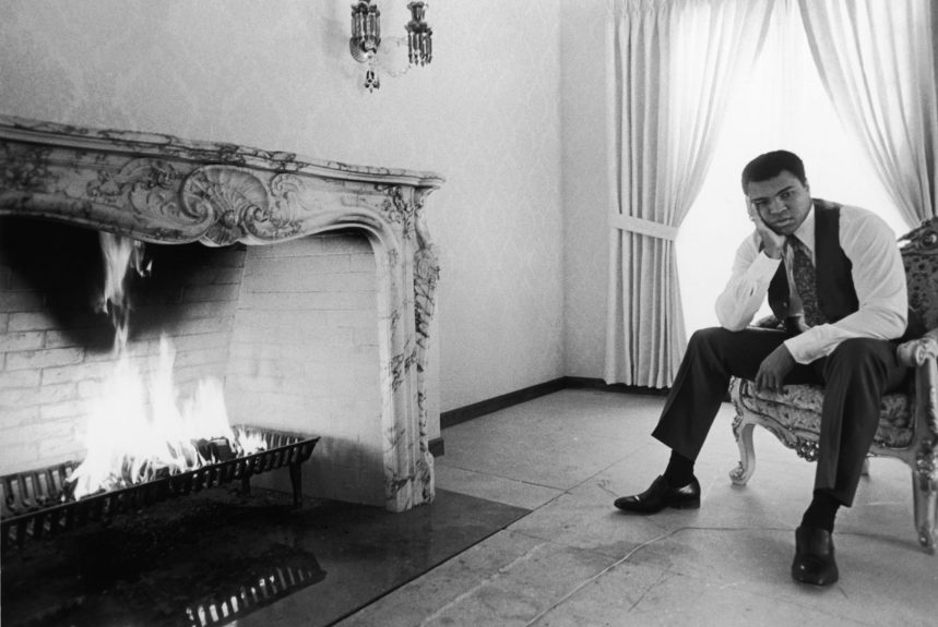 <p> Muhammad Ali in front of a large fireplace inside his Chicago, IL home for a photo shoot in December of 1976 (Ozier Muhammad/Ebony Collection)</p>