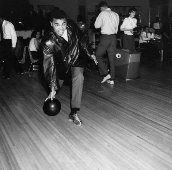 <p> Boxing champ Muhammad Ali lets loose at a bowling alley in Chicago, IL in 1965 (Isaac Sutton/Ebony Collection)</p>