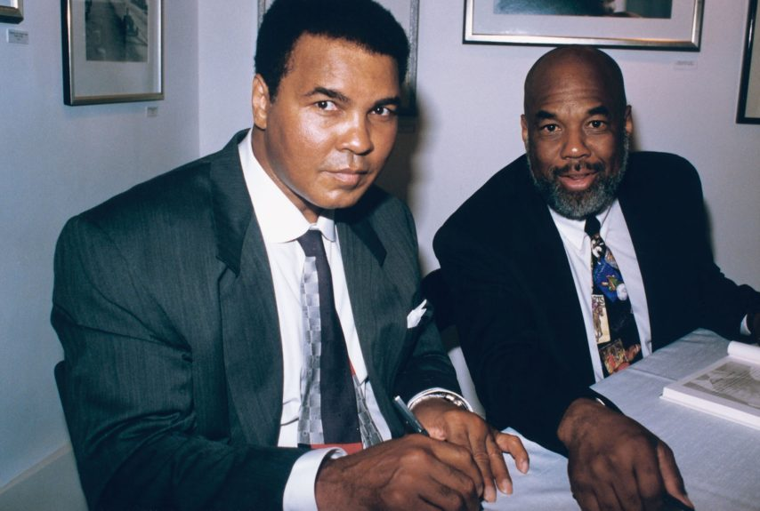 <p> Muhammad Ali and personal photographer Howard Bingham during Ali's book signing event in 1995 (Frederick Watkins, Jr./Ebony Collection)</p>