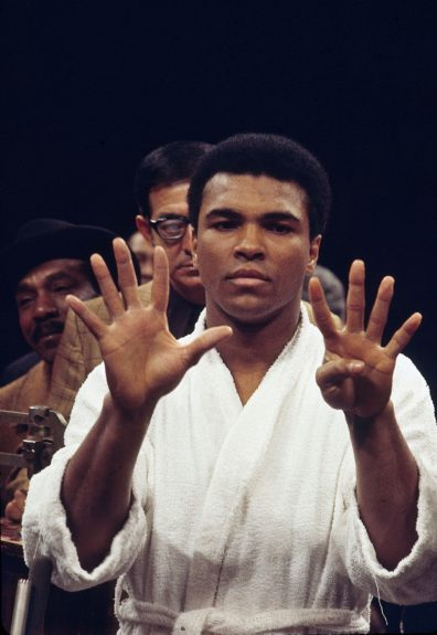 """<p> Muhammad predicting a nine-round victory for his bout with Oscar Bonavena on December 7, 1970 at New York's Madison Square Garden. """"The Champ"""", defeatedBonavena after 15-rounds. (Moneta Sleet, Jr./Ebony Collection)</p>"""