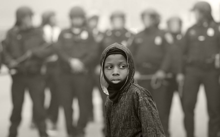 <p> 	BALTIMORE: AP10ThingsToSee - A boy stands in front of a police cordon Monday, April 27, 2015 following the funeral of Freddie Gray in Baltimore. (AP Photo/Matt Rourke)</p>