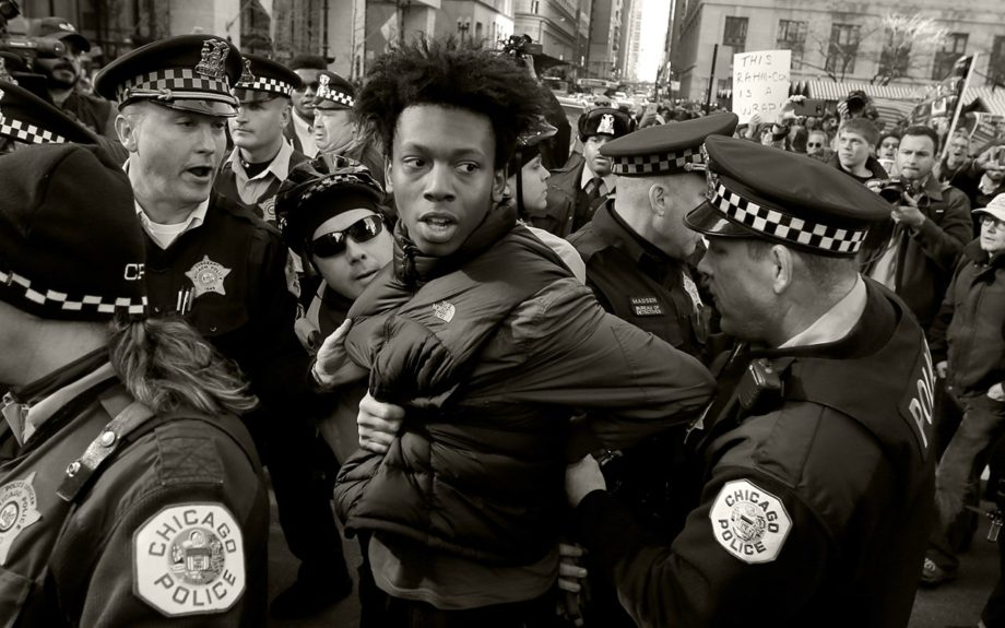 <p> 	CHICAGO: Lamon Reccord is taken into custody by Chicago police officers during a march calling for Chicago mayor Rahm Emanuel and Cook County State's Attorney Anita Alvarez to resign Wednesday, Dec. 9, 2015, in Chicago.. (AP Photo/Charles Rex Arbogast)</p>