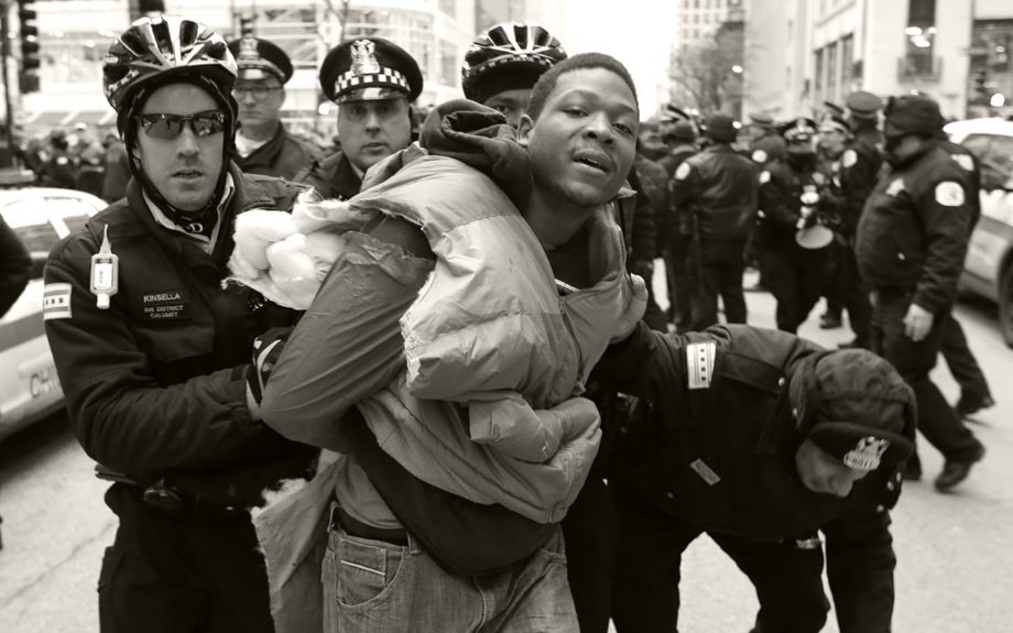<p> 	CHICAGO: Chicago Police officers take a protester into custody during a scuffle at a police bicycle barricade on Chicago's Magnificent Mile Thursday, Dec. 24, 2015, in Chicago... (AP Photo/Charles Rex Arbogast)</p>